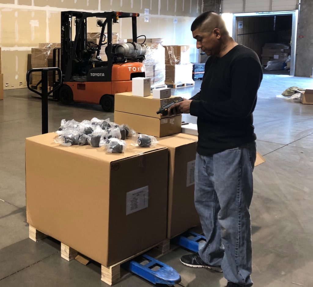 One of Finale Inventory's clients using Finale's Auto Parts Inventory Management in his warehouse